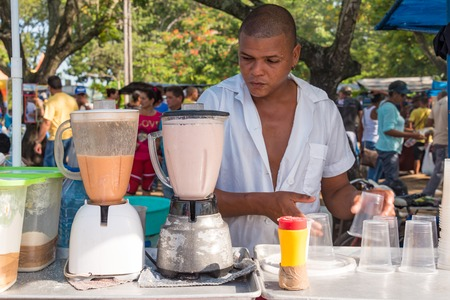 news stand: Cuba news: stand for milk shakes. Private person selling fruit milk shakes in the Sunday free market held in the Sandino area.  More variety of business are allowed nowadays after the internal economic changes to society Editorial