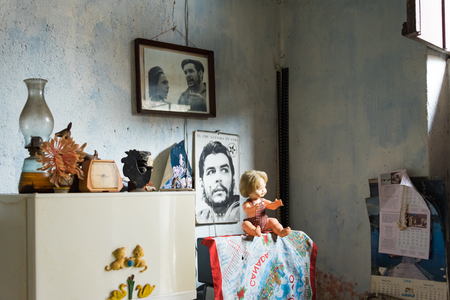 impoverish: Cuba news: Inside a Revolution supporters seniors couple house full of photos of communist leaders like Che Guevara and Fidel Castro. Images taken with permission of the elder couple.