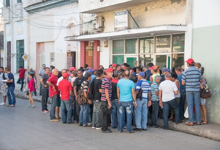 rewarding: Cuba news: store for rewarding best workers or benefits shop. Line outside a store which sells at better prices to selected best workers in their government run companies