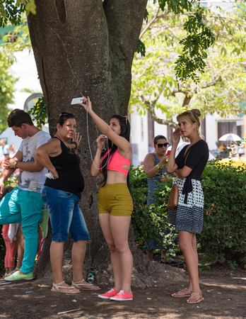 plazas: Cuba news: Wifi internet use in main cities plazas. Cubans brave all obstacles to connect to internet: some read emails and browse but most of them use applications to talk with family abroad.