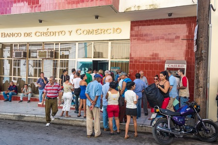 minimize: Cuba news: People linig in banks are common. Inefficient processes and overcontrol to minimize risks to almost zero make financial transactions a nightmare in the Caribbean Island