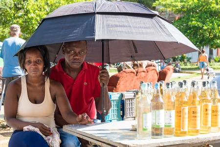 intense: Cuba news: Sellers protecting from the intense sun during a Sunday free market in the Sandino area. Braving the intense heat is one of the skills Cubans have had to learn as the climate changes for worst in the island.
