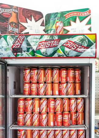 cristal: Cuba news: National beers like Bucanero and Cristal are scarce and hard to find. The demand overwhelms the supply. Importing brands like Brahma is necesary. This fridge is provided by the Cristal yet must be filled with another brand due to lack of supply Editorial