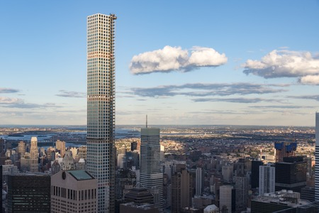 New York tours and attractions: 432 Park Avenue building highlighting the New York city skyline with its majestic height.  432 Park Avenue is a supertall residential building in midtown Manhattan, New York City and the second tallest building in New York