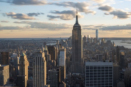 New York landmarks and attractions: Empire state building standing tall in the New York city skyline as seen from the Rock Observation Deck.  Empire State Building is a 102-story skyscraper located in Midtown Manhattan, New York City.