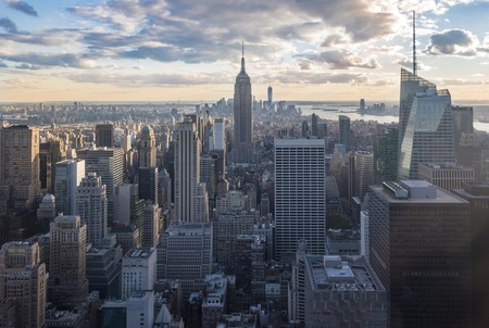New York attractions and sightseeing: City view with skyscrapers during sunset, seen from the Rock observation center.  New York has architecturally significant buildings in a wide range of styles spanning distinct historical and cultural periods.
