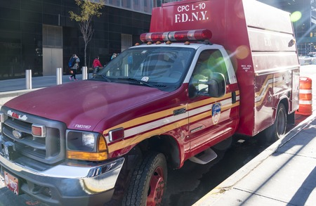 technical department: Fire van of FDNY or Fire Department of New York city parked outside its firehouse on Liberty street in New York city, USA.  FDNY provides fire protection, technical rescue, primary response to biological, chemical and radioactive hazards, and emergency me