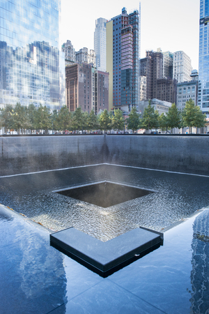 earlier: Ground Zero memorial or September 11 Memorial pool at the site of earlier World Trade Centre in New York city, USA.  911 memorial is the principal memorial commemorating the September 11 attacks of 2001. The memorial is located at the former location of
