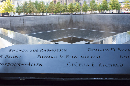 Names of victims carved at Ground Zero memorial or September 11 Memorial pool at the site of earlier World Trade Centre in New York city, USA.  911 memorial is the principal memorial commemorating the September 11 attacks of 2001. The memorial is located Editorial