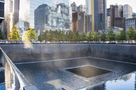 commemorating: Ground Zero memorial or September 11 Memorial pool at the site of earlier World Trade Centre in New York city, USA.  911 memorial is the principal memorial commemorating the September 11 attacks of 2001. The memorial is located at the former location of