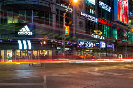 revitalizing: Dundas Square at night time, long exposure. The Toronto landmark is one of the busiest intersection in the city. Yonge-Dundas Square was first conceived in 1997 as part of revitalizing the intersection, and was designed by Brown and Storey Architects. Editorial