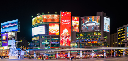 conceived: Dundas Square at night time, long exposure. The Toronto landmark is one of the busiest intersection in the city. Yonge-Dundas Square was first conceived in 1997 as part of revitalizing the intersection, and was designed by Brown and Storey Architects. Editorial