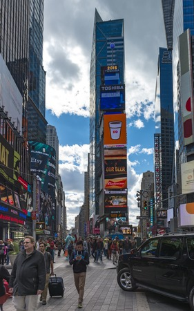 times square new york: Times Square New York City attraction: Everyday at Times Square which is a famous landmark and a major tourist attraction.  Times Square is a major commercial intersection and neighborhood in Midtown Manhattan, New York City. Editorial