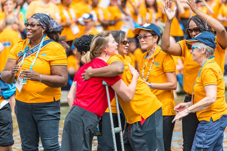 vital: Toronto 2015 Pan Am and Parapan Am Games volunteers are honored by the city at Nathan Phillips Square. The mayor and the games orginizers recognize the vital help the volunteers gave the event success.