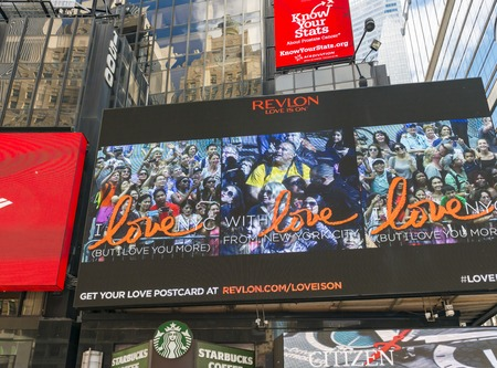 american media: Revlon Love is On screen on Times Square, New York city. The advertisement campaign gets you free pics for sharing in social media. Revlon is an American cosmetics, skin care, fragrance, and personal care company founded in 1932