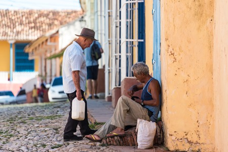 everyday people: Cuba Tourism: Trinidad and its people. Everyday scene in the Unesco World Heritage Stie. A look to the vintage colonial village and the Cuban people living a normal live in there
