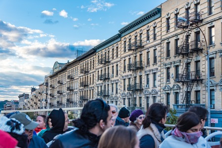 historic district: New York City Historic District Architectural Tours: People on double decker bus sightseeing the marvellous vintage buildings from different epochs and styles conserved for the tourist to see. New York City is the major entrance to legal inmmigration in t