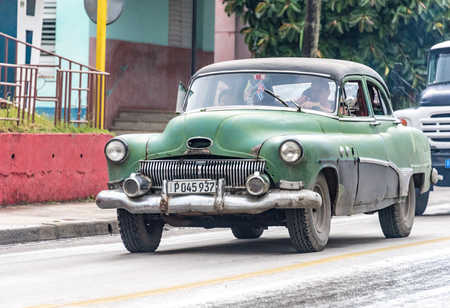 classic santa: Santa Clara, Cuba transportation: Old classic American car carrying passengers in Santa Clara, Cuba.  Cuba has thousands of old classic American cars making them a major tourist attraction These cars are used as taxis mainly for tourist transportation.