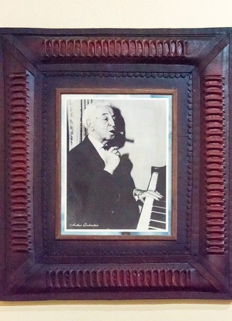 loved: Famous Cuban cigar smokers: Portrait of Arthur Rubinstein at the gallery of famous smokers in the Habano house in Santa Clara, Cuba.  The legendary pianist loved Cuban cigars, especially Montecristo No. 2s and 3s, so much that he owned a tobacco plantatio