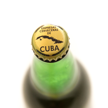 cuban culture: Cuba made products: Branding on lid of Bruja beer bottle with the words empresas cerveceras de cuba and a map of Cuba.  Cuba is famous for its beverages like rum, beer and wine through which it promotes Cuban culture across the globe.