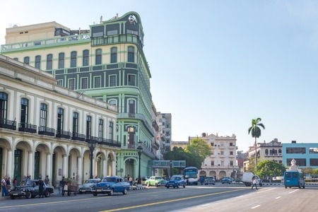 historic buildings: Cuba architecture and attractions: Colonial architecture buildings, transportation and people on street at Central Park in Havana, Cuba.  Parque Central or Central Park is a place with historic buildings and landmarks around it.