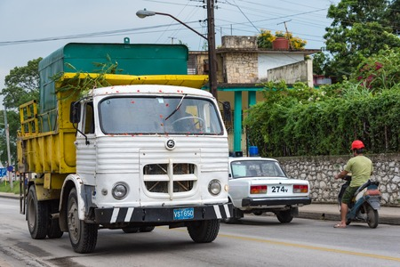 however: Santa Clara, Cuba traffic scenes: Vehicles of all sizes from trucks to motor bikes plying on street.  For long time, there was an embargo on import of cars. However, things have changes now and Cubans can buy new cars without special permissions.