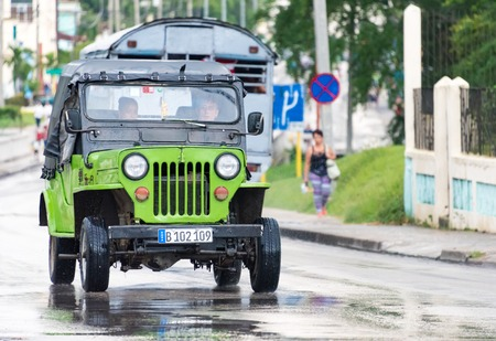 selfemployed: Santa Clara, Cuba transport: Classic American Jeep used as private taxi for transporting people with in the city.  Cuba Privatized State Taxi Services. In addition to the state taxi services many self-employed provide service with private cars, usually ol Editorial