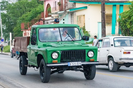 selfemployed: Santa Clara, Cuba transportation unsafe practices:Pickup truck converted to private taxi transporting people in its open top carriage.  Cuba Privatized State Taxi Services. In addition to the state taxi services many self-employed provide service with pri