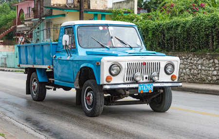 serv: Local taxis in Santa Clara, Cuba: Pickup truck converted to private taxi for transporting people. It has an open top carriage with benches to sit.  Cuba Privatized State Taxi Services. In addition to the state taxi services many self-employed provide serv