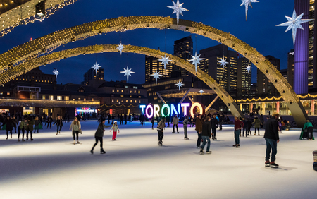 Nathan Phillips Square and the Toronto Sign at night. Toronto inhabitants and visitors can enjoy a free skating rink in the square which is a major tourist landmark in the city