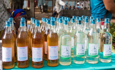 sunday market: Sunday free market, Sandino, Cuba: Wine and vinegar produced locally bottled under the brand El Natural being sold in the Sunday market in Santa Clara.  The Sunday free market is a great success and offers a variety of products to buy at cheap prices.