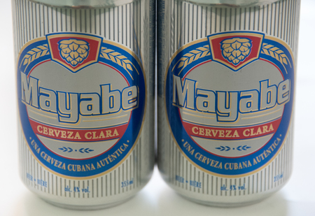 intrigue: Cuba made products: Mayabe light beer cans produced in Cuba.  Mayabe brand of beer is produced by Cerveceria Bucanero SA (CBSA ). The brand takes its name from a valley in eastern Cuba a region full of mystery and intrigue. Editorial