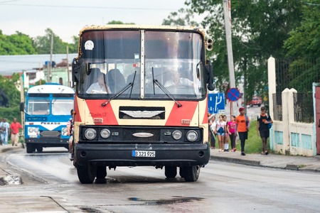 easing: Public transport, Santa Clara, Cuba: Government run buses have helped in easing the transport problems to some extent.  Transportation in Cuba is improving after the economic reforms taken up by Raul Castro government.