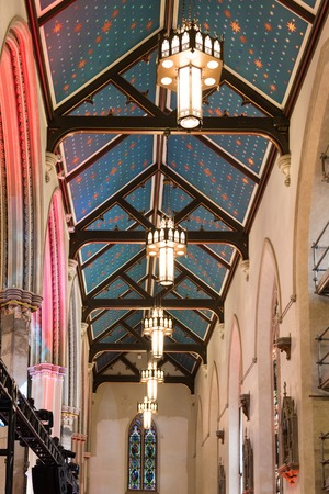 revitalization: Ceiling and lamps in Saint Michael Cathedral in Toronto which opens its doors to the public after four years of reconstruction.  In the event, artists and architects were explaining visitors the delicate process of revitalization. The building is part of