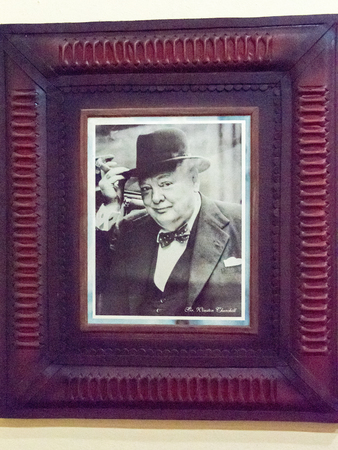 prime minister: Famous cigar smokers: Portrait of Sir Winston Churchill at the gallery of famous smokers in the Habano house in Santa Clara, Cuba.  The legendary British prime minister had a great affection for cigars and was hardly ever seen without his beloved Romeo y  Editorial