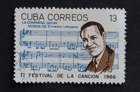 composer: Cuban 1966 stamp on La Comparsa by Ernesto Lecuona. Stamp commemorating second Festival de la Cancion of 1966.  Ernesto Lecuona was a Cuban composer and pianist of worldwide fame. La Comparsa is a carnival procession in the Cuban style. Editorial