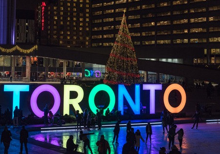 nightime: Nathan Phillips Square and the Toronto Sign at night. Toronto inhabitants and visitors can enjoy a free skating rink in the square which is a major tourist landmark in the city
