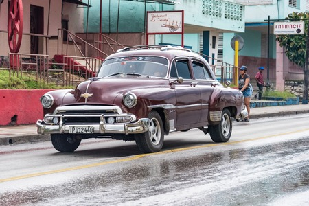 tourist attraction: Cuba tourist transportation: Old vintage American car in Santa Clara, Cuba.  Cuba has thousands of old classic American cars making them a major tourist attraction These cars are used as taxis mainly for tourist transportation. Editorial