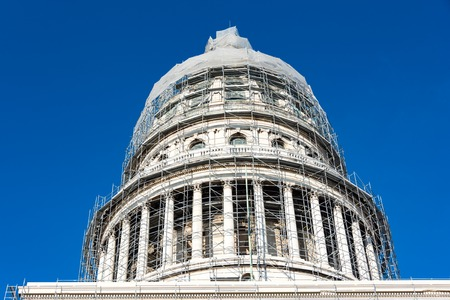 capitolio: Preserving historic buildings in Cuba: Revitalizing El Capitolio in Havana using scaffolding frames all around the building.  El Capitolio, or National Capitol Building in Havana, Cuba, was the seat of government in Cuba until after the Cuban Revolution i Editorial