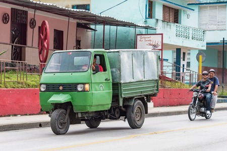 means of transportation: Cuba local Transportation: Three wheeled auto rickshaw used for transporting goods in Santa Clara.  The auto rickshaw is a common form of urban transport as taxi in Cuba providing cheap means of moving goods and people within the city.