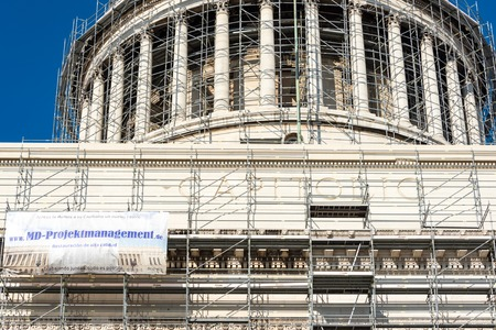 capitolio: Conserving heritage: Revitalization works on El Capitolio in Havana, Cuba using scaffolding frames all around.  El Capitolio, or National Capitol Building in Havana, Cuba, was the seat of government in Cuba until after the Cuban Revolution in 1959, and is