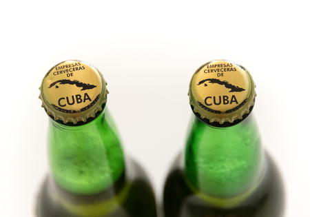cuban culture: Products de Cuba: Branding on lids of Bruja beer bottles with the words empresas cerveceras de cuba and a map of Cuba.  Cuba is famous for its beverages like rum, beer and wine through which it promotes Cuban culture across the globe. Editorial