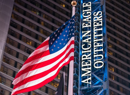 retailer: American Eagle Outfitters: Blue and white sign in Times Square in New York city.  American Eagle Outfitters is an American clothing and accessories retailer, headquartered in the Southside Works Neighborhood of Pittsburgh, Pennsylvania. It was founded in