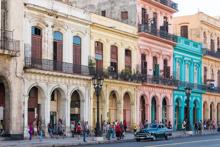 historic buildings: Cuba tours and attractions: Colorful colonial architecture with arches and balconies at Central Park in Havana, Cuba.  Parque Central or Central Park is a place with historic buildings  and landmarks around.