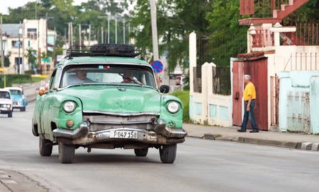 classic santa: Cuba transportation: Old vintage American car in Santa Clara used as taxi.  Cuba has thousands of old classic American cars making them a major tourist attraction These cars are used as taxis mainly for tourist transportation.