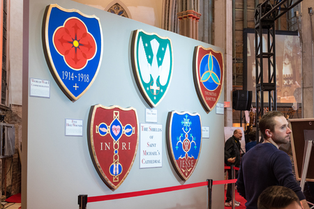 revitalization: Saint Michael Cathedral in Toronto opens its doors to the public after four years of reconstruction.  The shield of the cathedral on display.   In the event, artists and architects were explaining visitors the delicate process of revitalization. The build