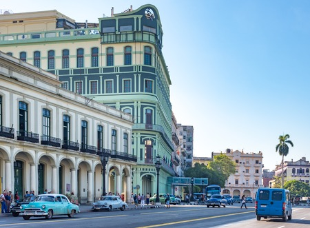 historic buildings: Colonial architecture Cuba: Colonial buildings, transportation and people on street at Central Park in Havana, Cuba.  Parque Central or Central Park is a place with historic buildings and landmarks around it. Editorial