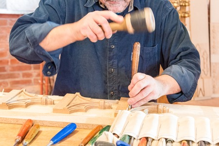 revitalization: Dragan Milenic carves wood in Saint Michael Cathedral in Toronto which opens its doors to the public after four years of reconstruction.  In the event, artists and architects were explaining visitors the delicate process of revitalization. The building is
