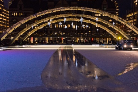 pool halls: Nathan Phillips Square and the Toronto Sign at night. Toronto inhabitants and visitors can enjoy a free skating rink in the square which is a major tourist landmark in the city