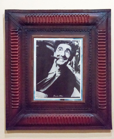 owes: World famous cigar smokers: Portrait of Groucho Marx at the gallery of famous smokers in the Habano house in Santa Clara, Cuba.  The most recognized member of the Marx brothers owes at least some of his recognition to his cigar, always hanging from his mo Editorial